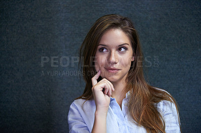 Buy stock photo Shot of a beautiful young woman making a decision