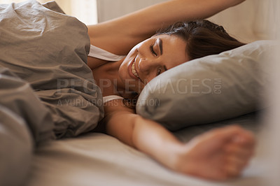 Buy stock photo Gorgeous brunette stretching on a bed