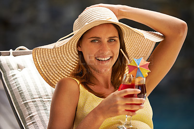 Buy stock photo Young woman sitting in the sun with a cocktail