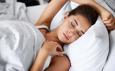 Buy stock photo Shot of a beautiful young woman sleeping in her bed