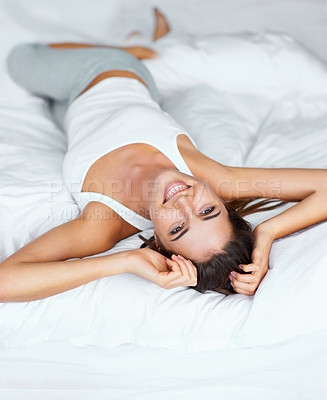 Buy stock photo Portrait of a young woman lying in bed