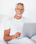 A senior retired happy man with a laptop