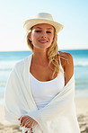 Young pretty woman wearing a shawl at the sea shore