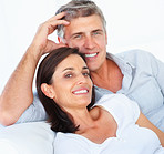 Closeup of a happy couple relaxing together over white background