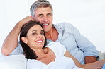 Happy couple relaxing together over white background