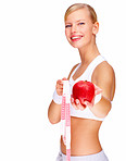 Portrait of smiling young female holding red apple and measuring tape