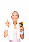 Health concepts - Healthy young woman pointing upwards