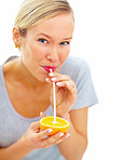 Young pretty girl sucking orange juice with a straw