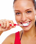 Pretty young woman brushing her teeth isolated