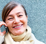Portrait of a happywoman using mobile phone