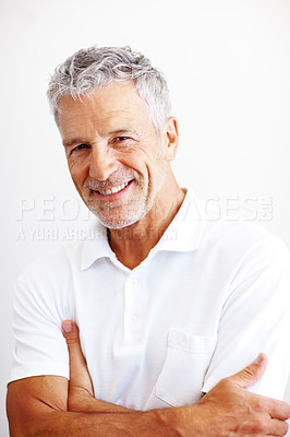 Buy stock photo Confident senior man in white t-shirt smiling confidently against a white background - copyspace