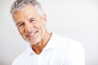Buy stock photo Portrait of a happy mature man smiling