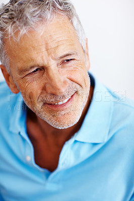 Buy stock photo Shot of a handsome mature man looking away