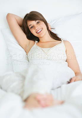 Buy stock photo Smiling young woman resting in the bed