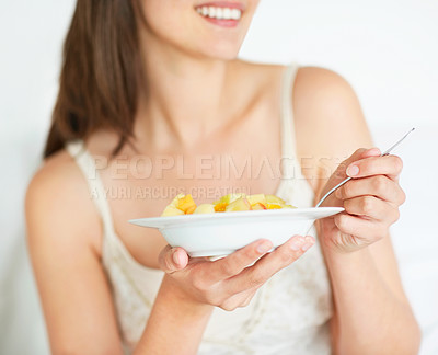 Buy stock photo Happy young lady eating fruit salad
