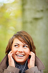 Young happy woman listening to music