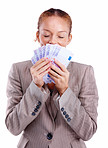 Successful business woman smelling euro notes