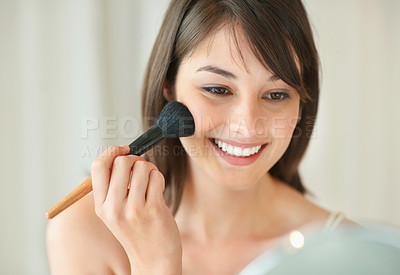 Buy stock photo Happy young woman applying make up in a mirror