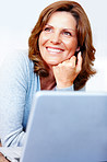 Smiling young female using laptop - Copyspace