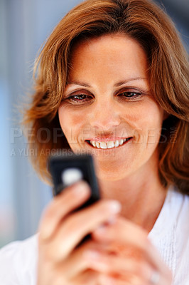 Buy stock photo Pretty young female text messaging on mobile