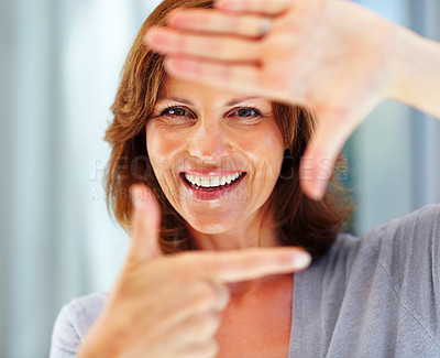 Buy stock photo Happy young female making a frame with her hands