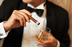 Wealthy man holding cigar and brandy
