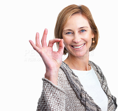 Buy stock photo Attractive mature lady showing the ok sign isolate
