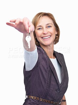 Buy stock photo Mature woman giving a key over white background