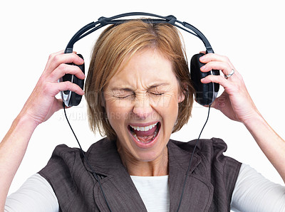 Buy stock photo Excited mature woman listening to music and scream