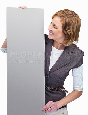 Buy stock photo Mature lady looking at empty bill board in hand ag