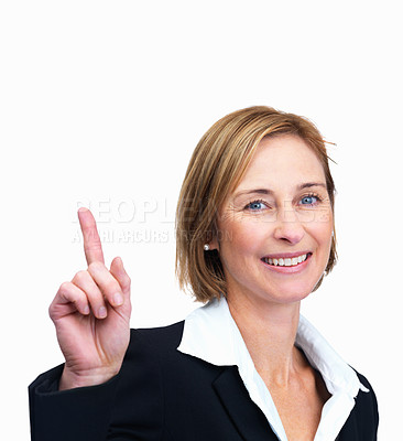 Buy stock photo Portrait of a happy mature woman pointing upwards
