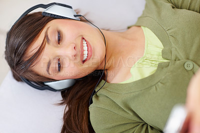 Buy stock photo Top view of a cute female hearing music on  mp3