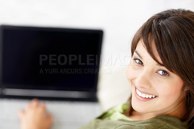 Buy stock photo Beautiful young female using a laptop
