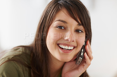 Buy stock photo Closeup of a female enjoying a conversation over t