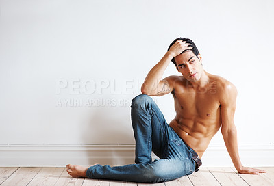 Buy stock photo Portrait of a relaxed young man posing thoughtfully on the floor without a shirt on - Copyspace