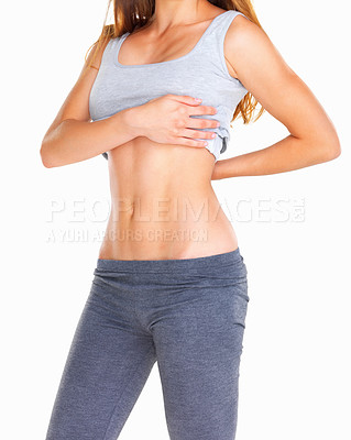 Buy stock photo Woman showing off her abs against white background
