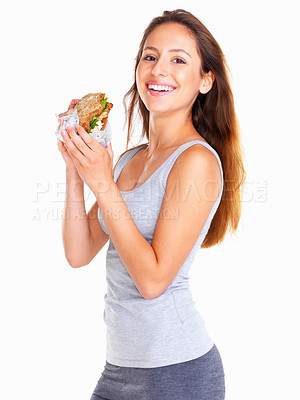 Buy stock photo Side view of woman holding a sandwich