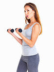 Woman concentrating on working out her arms