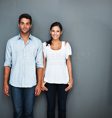 Buy stock photo Playful couple standing against wall
