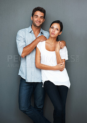 Buy stock photo Attractive couple standing against wall