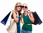 Happy young girls standing with shopping bags