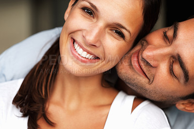 Buy stock photo Pretty woman smiling while man cuddles her