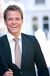 Portrait of laughing young businessman