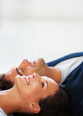 Buy stock photo Happy couple lying on the floor