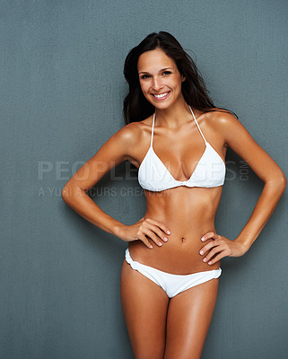 Buy stock photo Sexy woman standing against a wall in a bikini