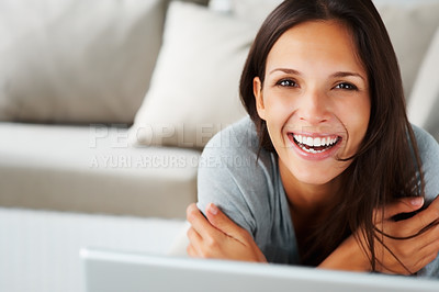 Buy stock photo Pretty woman lying on sofa with arms crossed