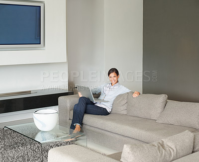 Buy stock photo Pretty woman sitting in modern living room