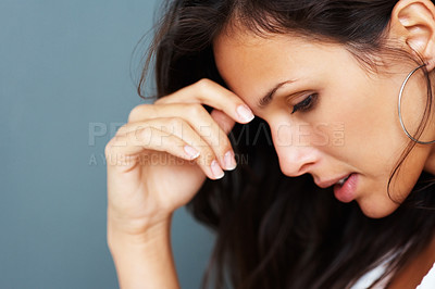 Buy stock photo Pretty woman looking at floor with hand on head