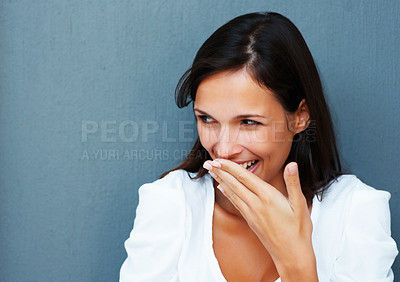 Buy stock photo Woman with hand over mouth against blue background