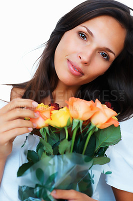 Buy stock photo Pretty woman holding flowers against white background looking wistful